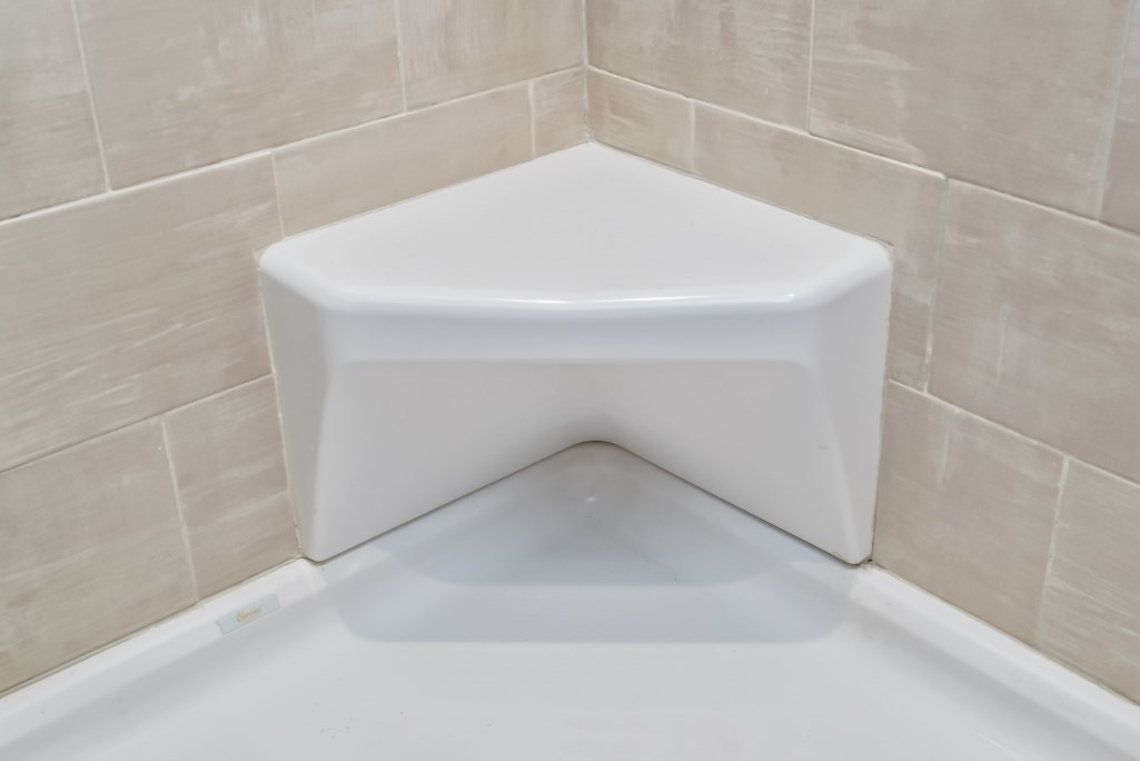 Opt. Fiberglass Corner Shower Seat | R-Anell Homes